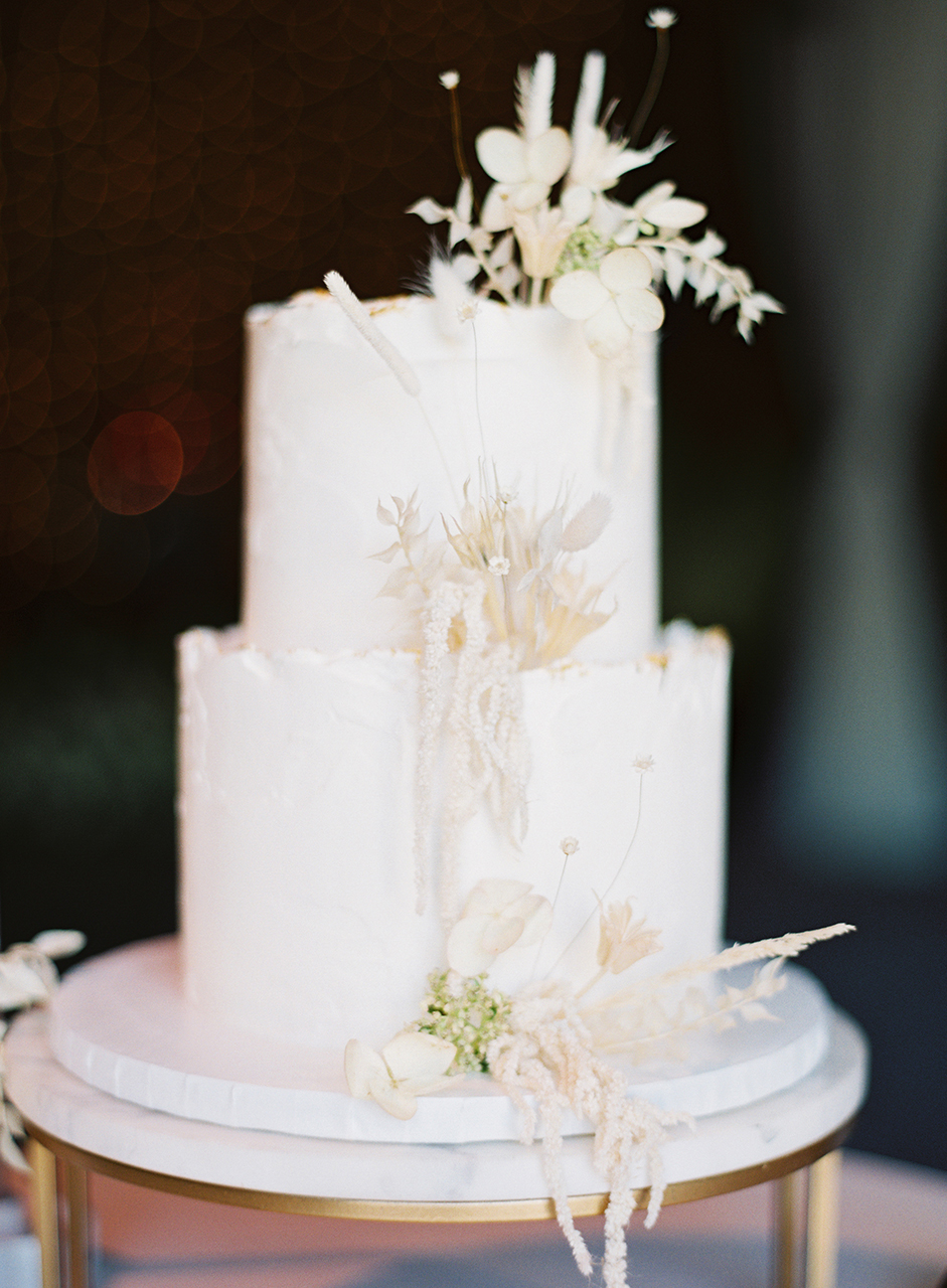 two-tier confection white wedding cake