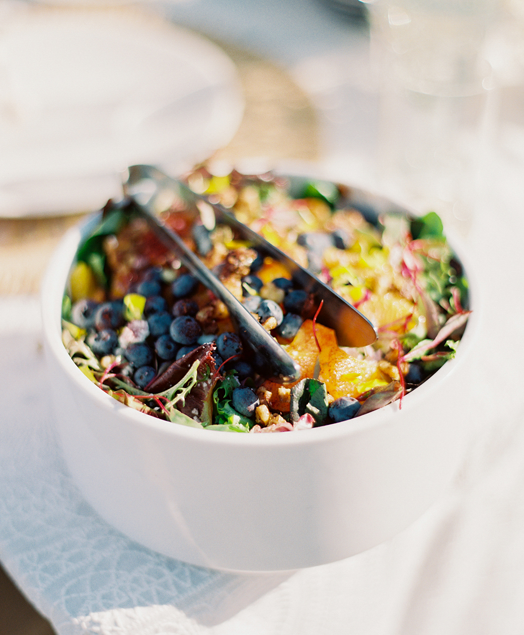 wedding blueberry salad white bowl with tongs
