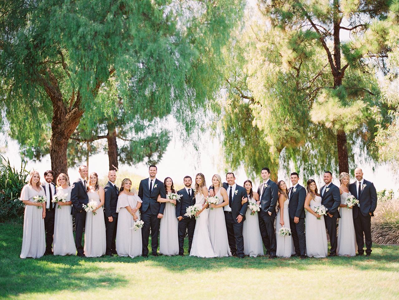 wedding party pale dresses dark gray tuxedos