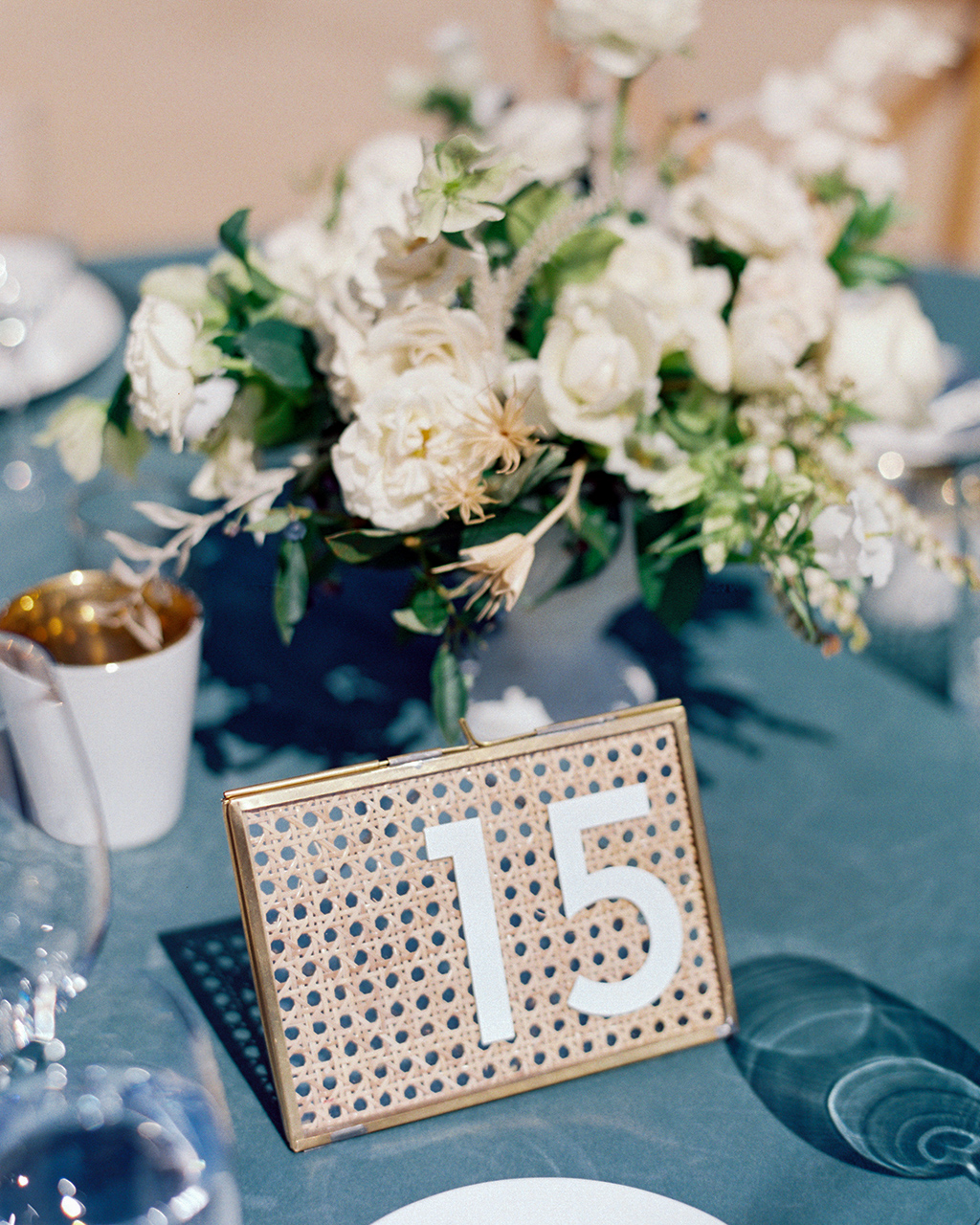 sage-colored velvet linens cane backing table numbers