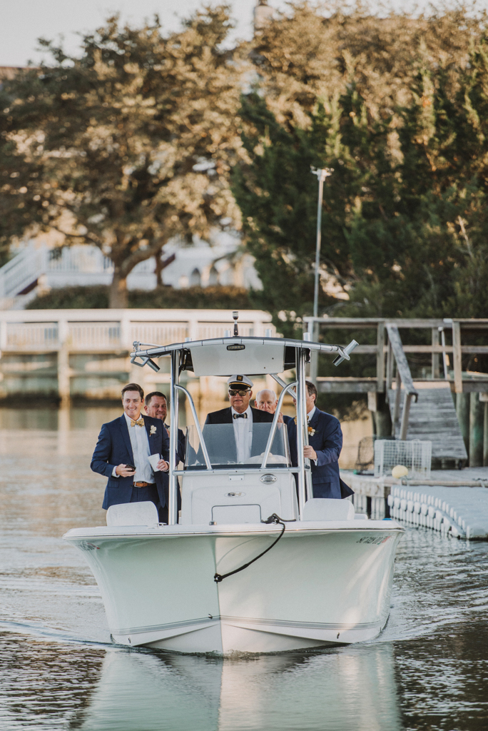 groom and groomsmen riding boat