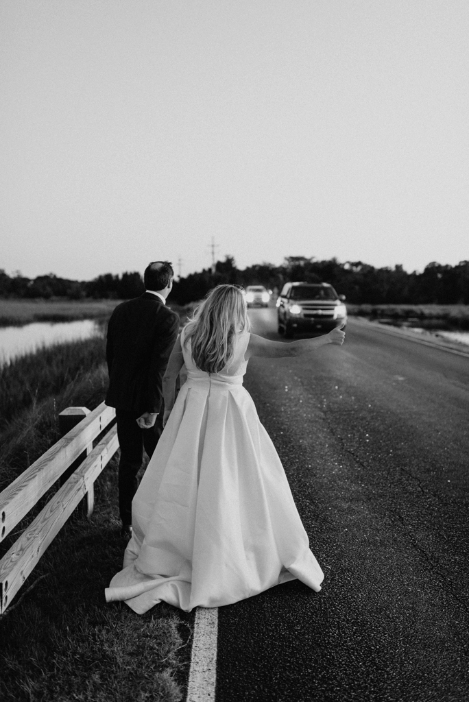 bride and groom hitchhiking