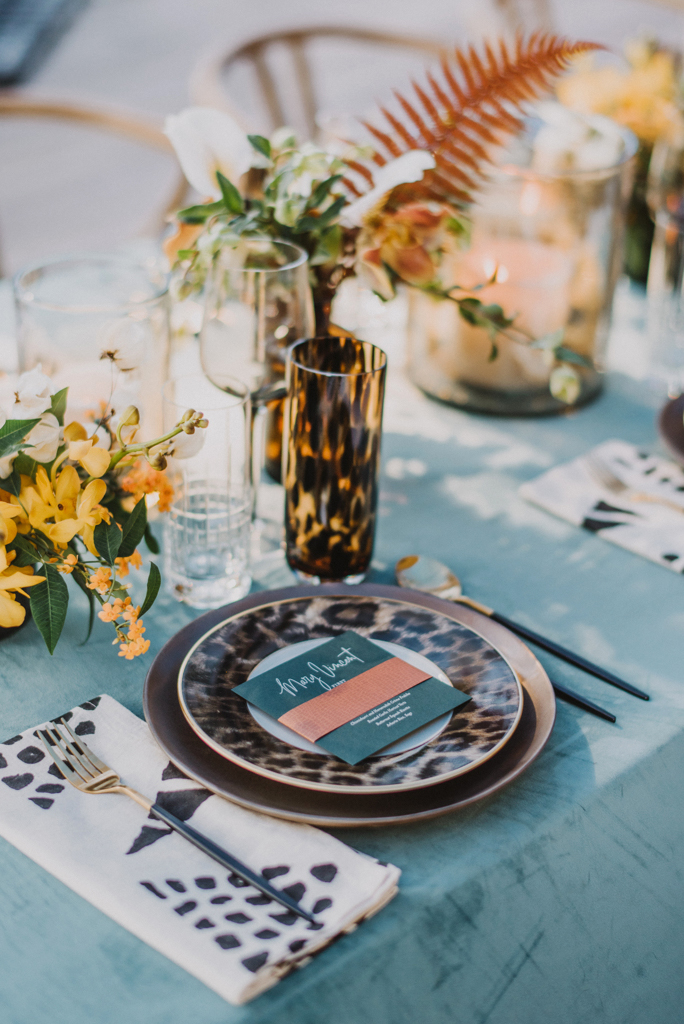 place setting featuring various jungle animal prints