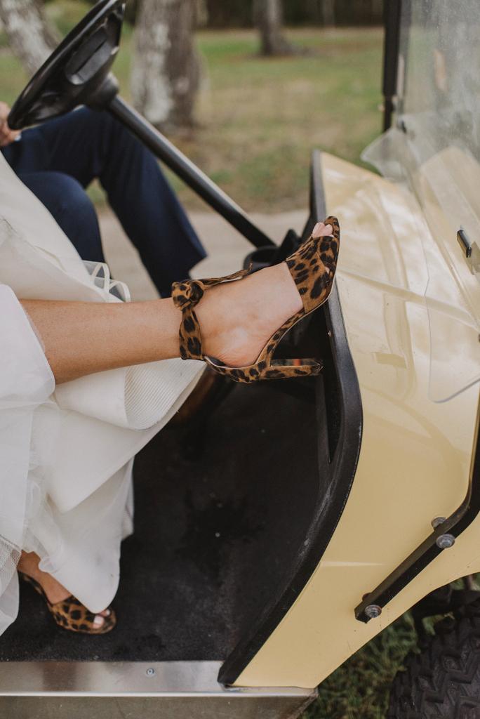 bride revealing leopard print high heels
