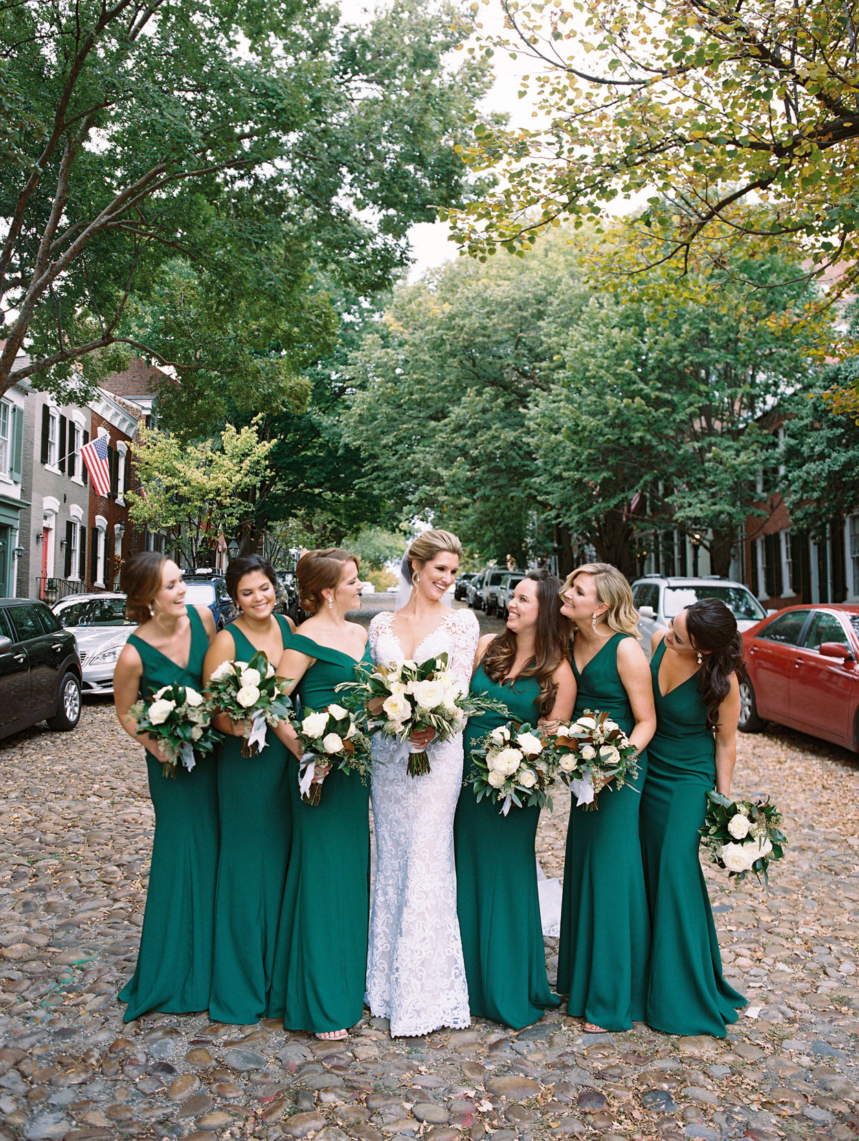bride with bridesmaids in green dresses