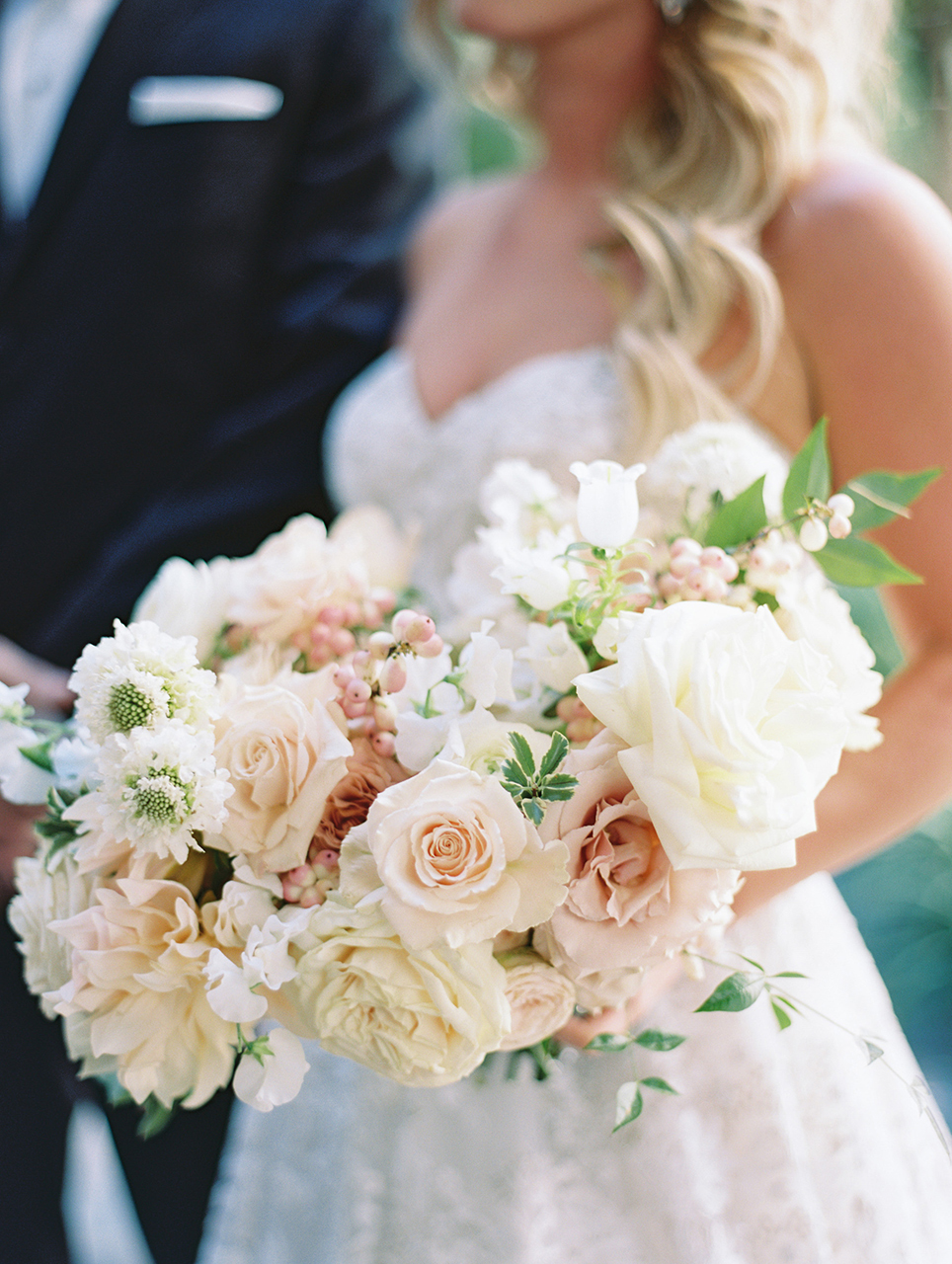 wedding bride bouquet floral blooms and greenery