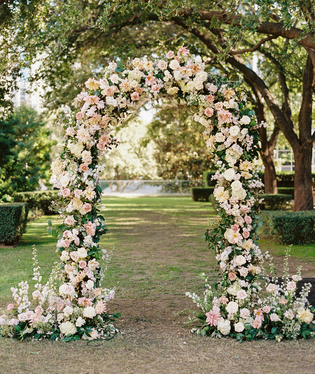 floral arch color scheme of white, blush, ivory, and greenery