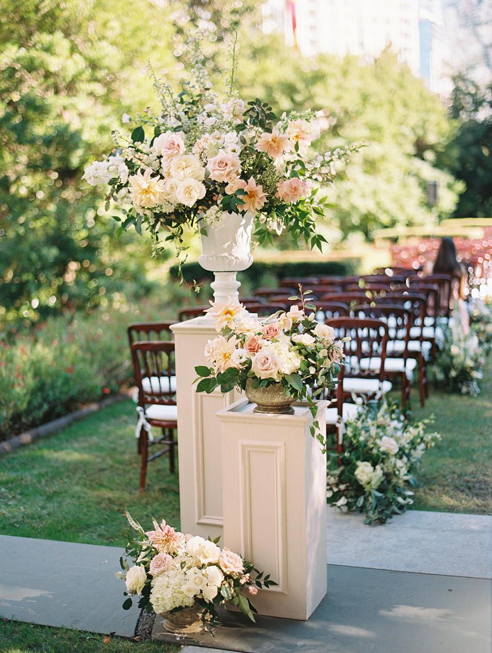 two columns large flower arrangement urns