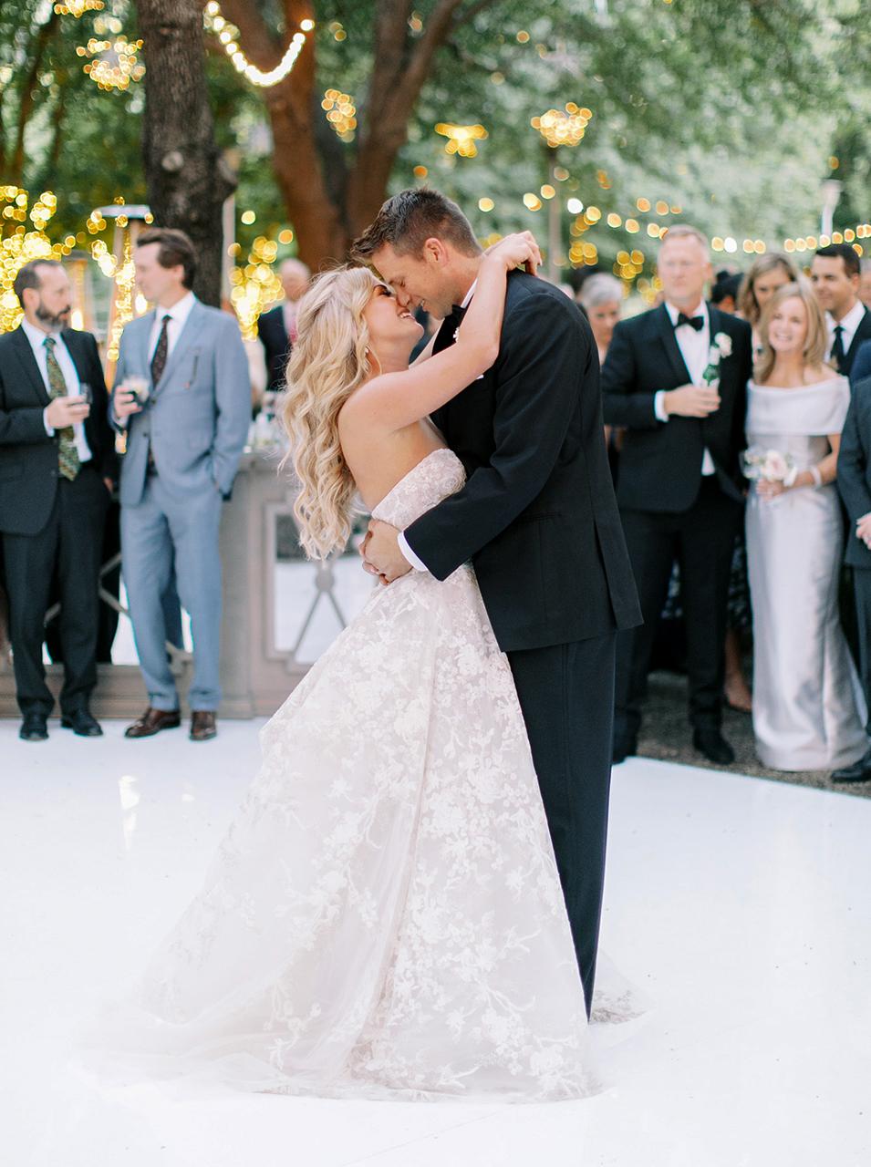 bride groom first dance outdoors white floor