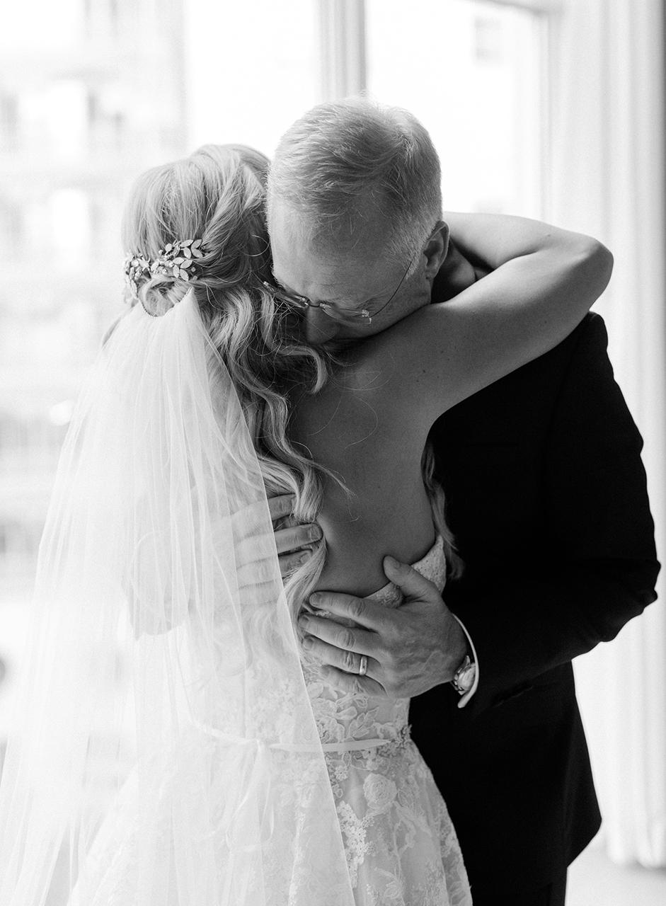 wedding bride father first look hug