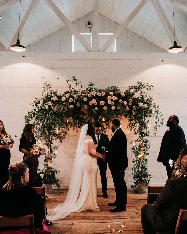 stephanie taurean wedding ceremony arch
