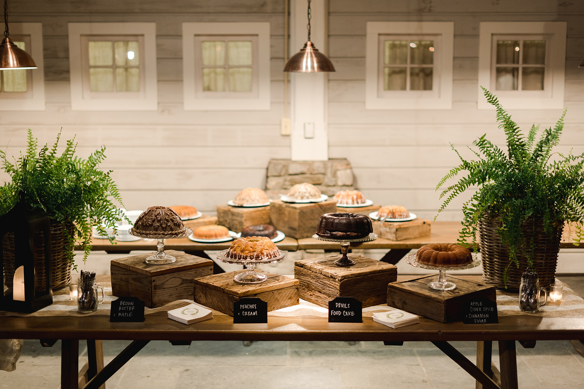 wooden rehearsal dinner dessert tables with bundt cakes
