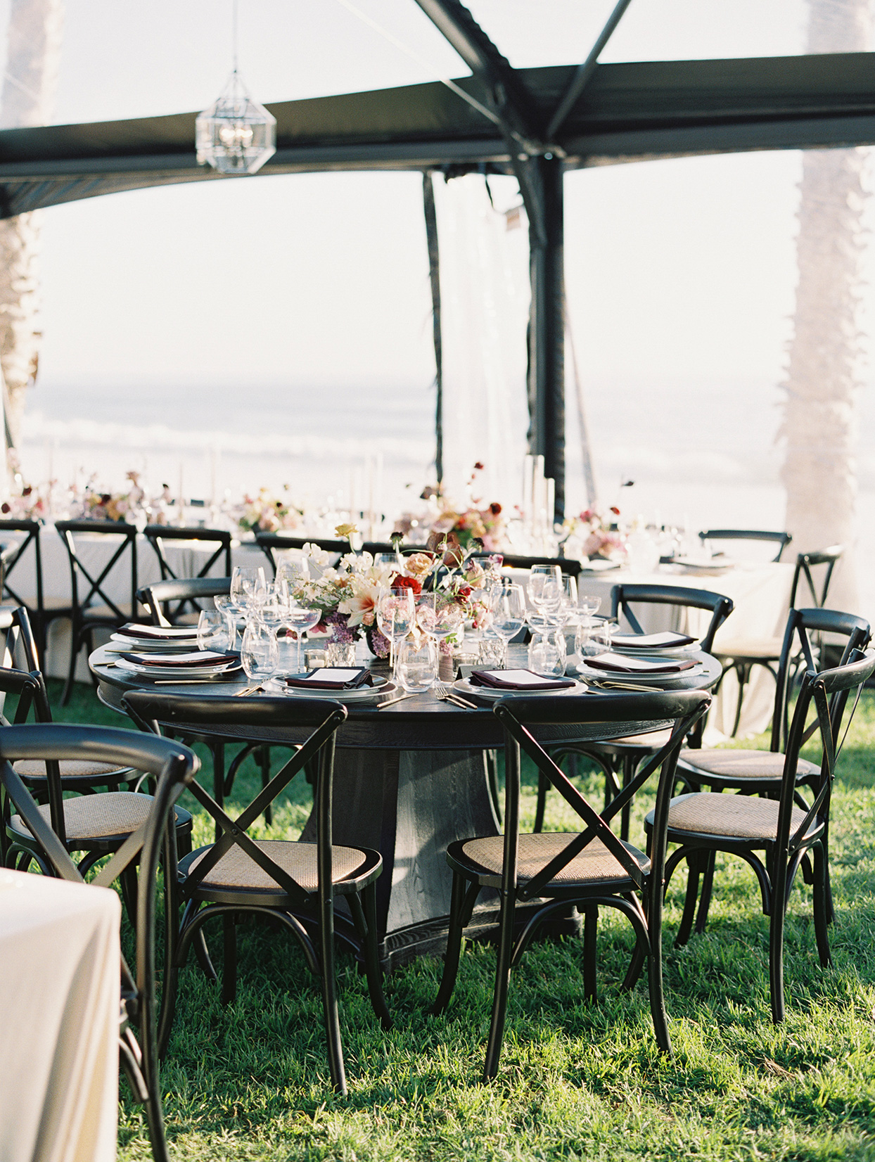 round black reception table with chairs on lawn