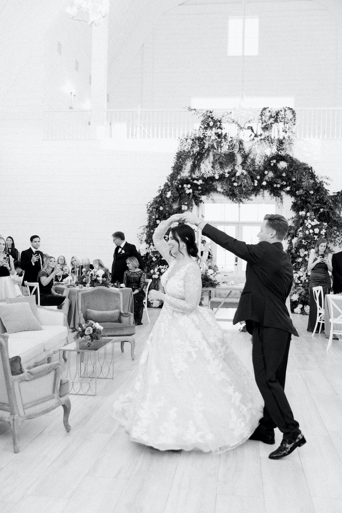 groom twirling bride during wedding couple first dance