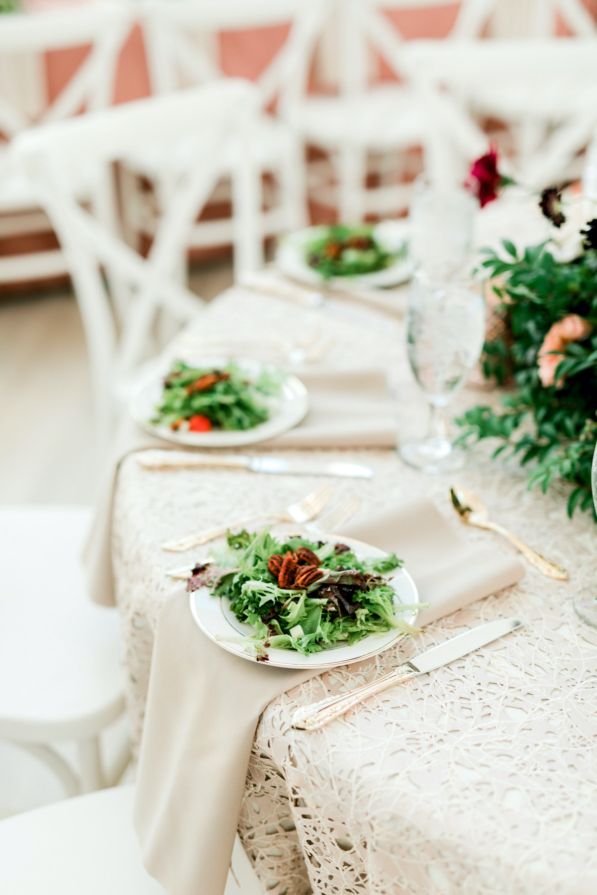elegant white place settings with salad