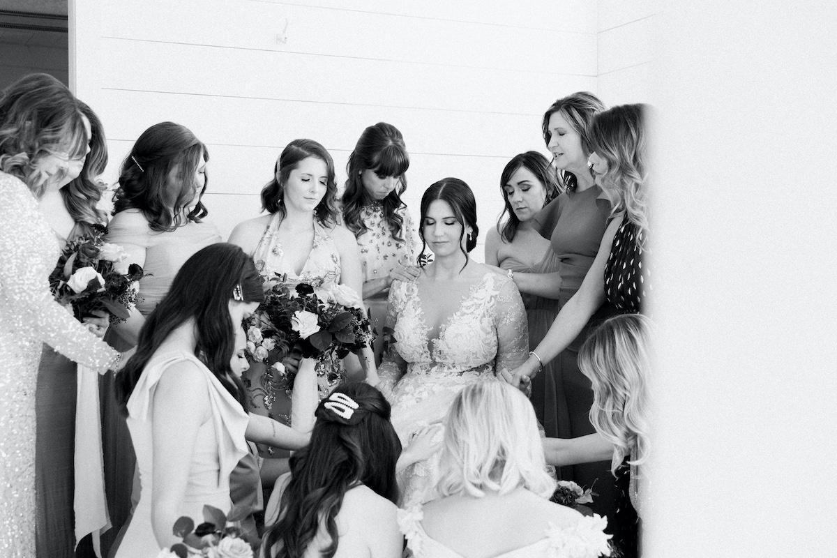 women praying for bride before wedding