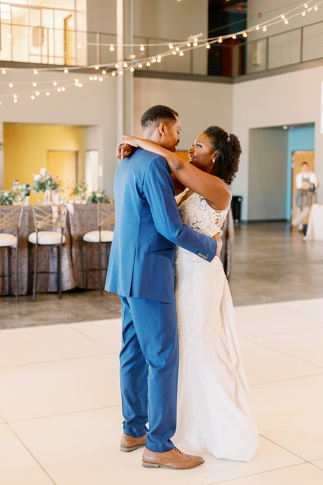 wedding couple first dance in industrial space