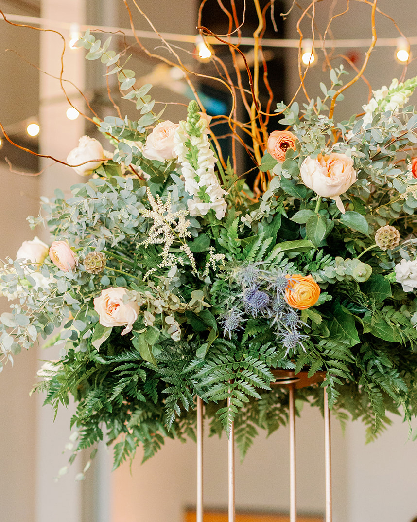 large reception centerpieces with ferns and flowers