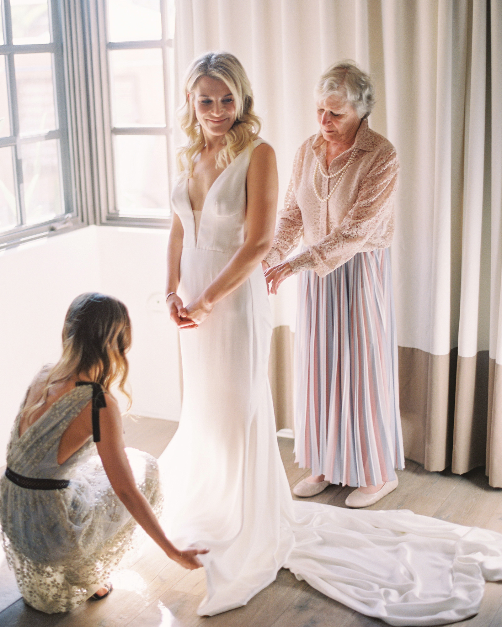 bride getting ready in bridal gown