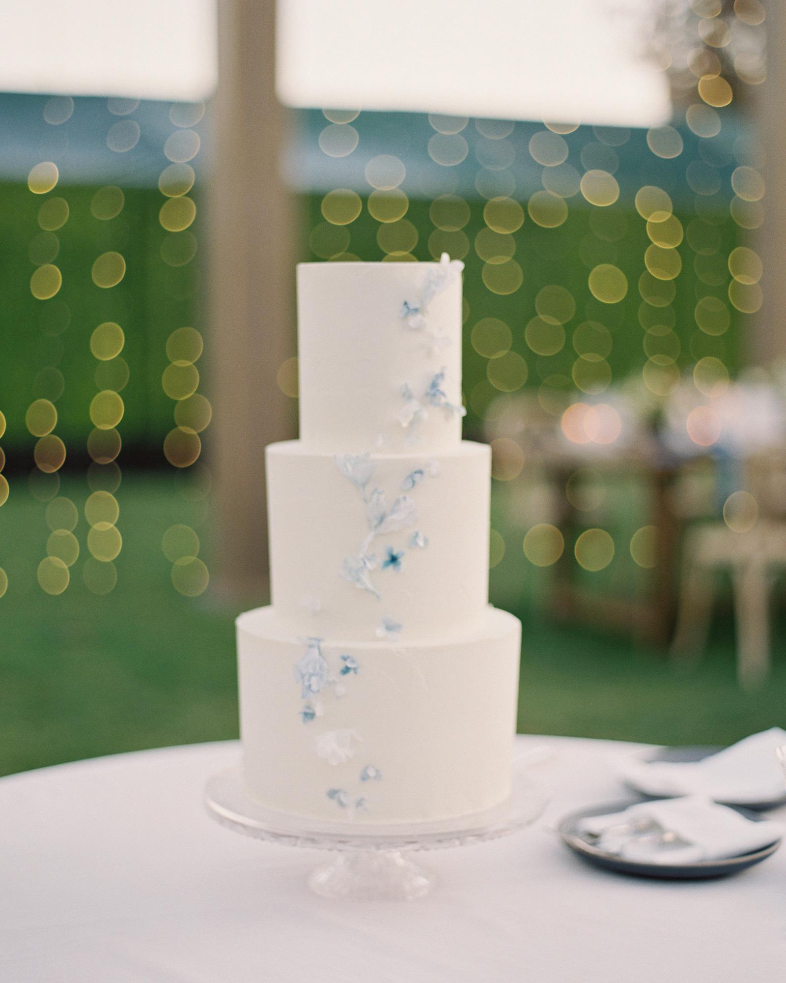 3-tiered white wedding cake blue and white embellishments