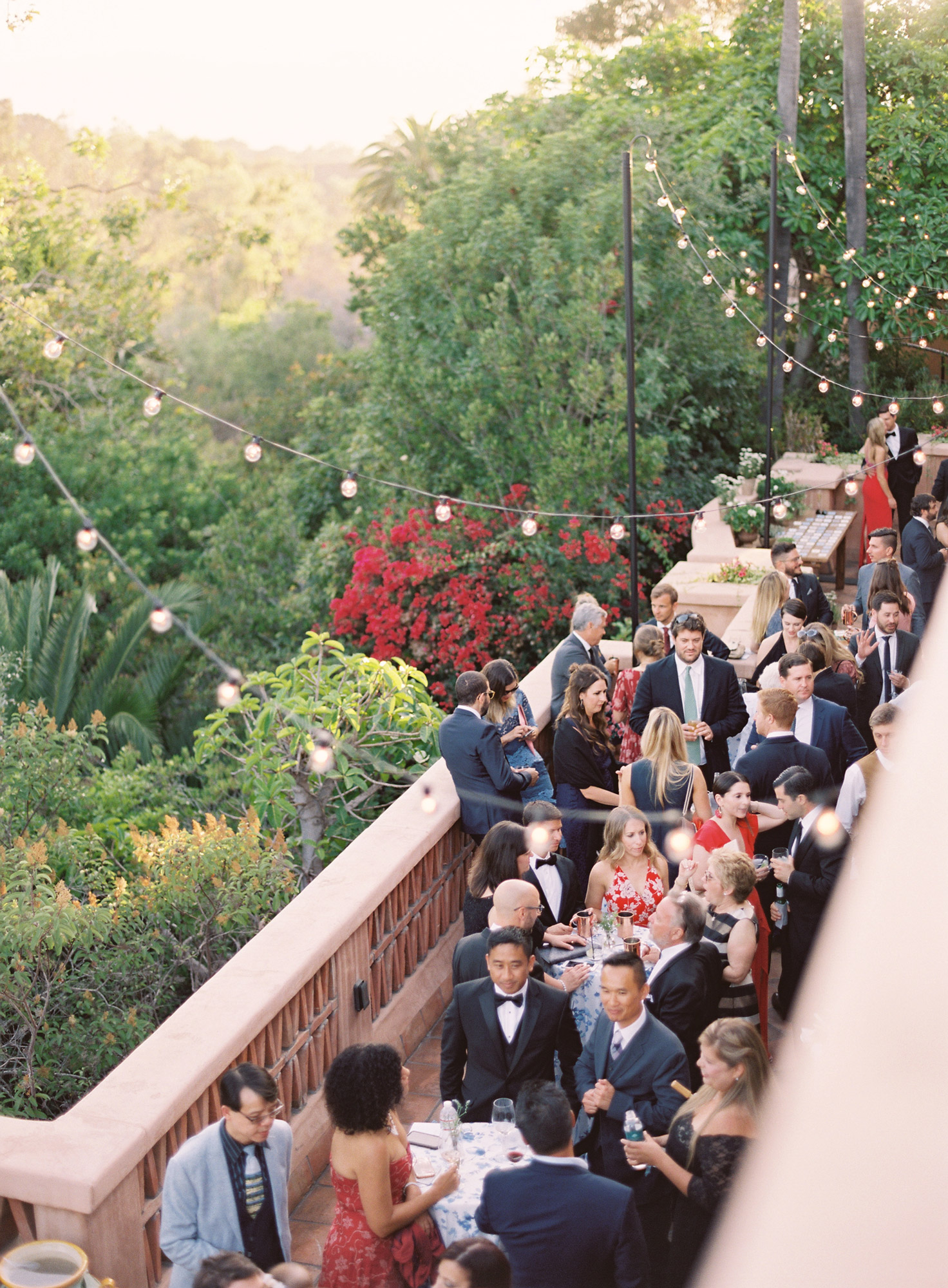 guests on balcony for cocktail hour