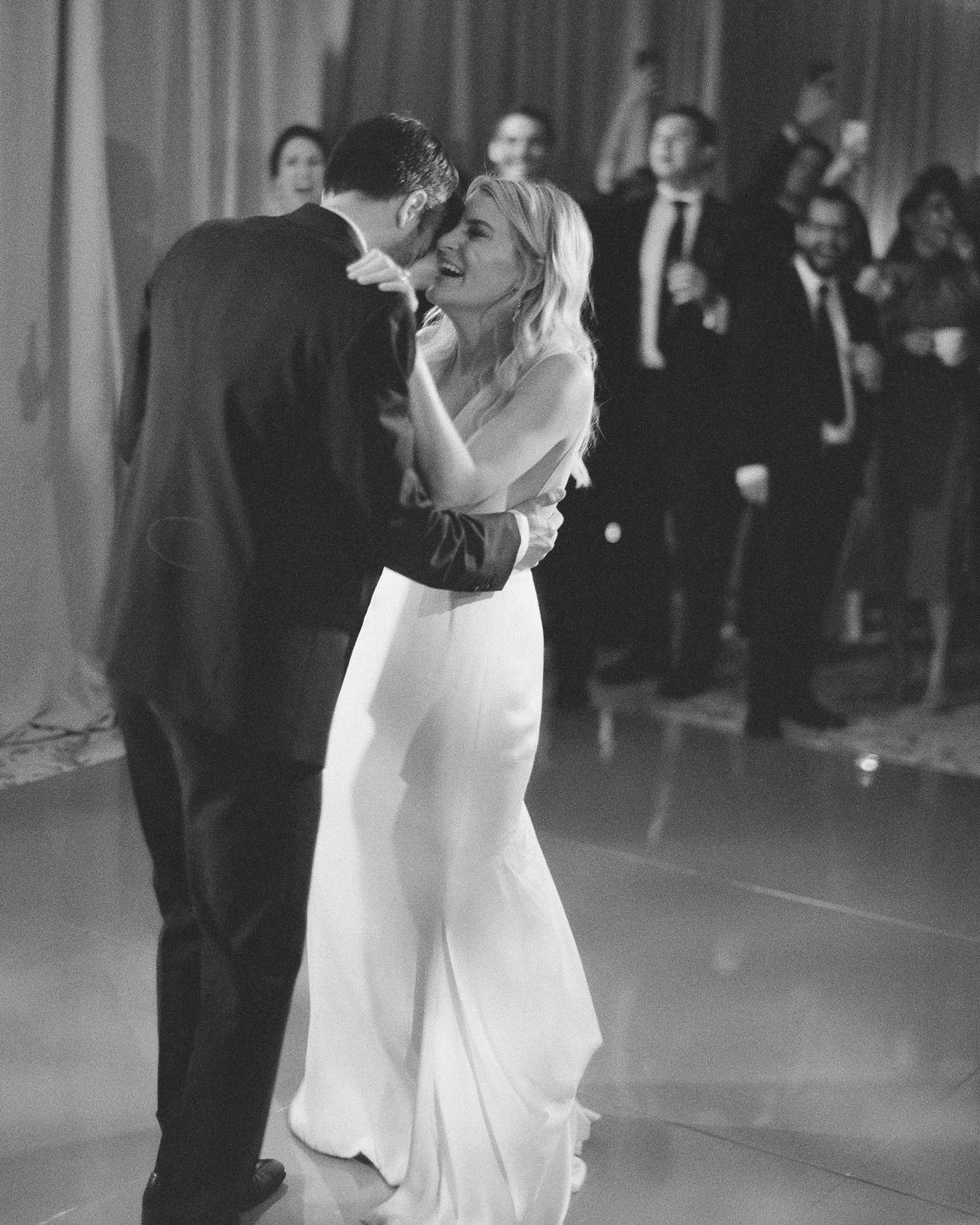 black and white photo wedding couple's first dance