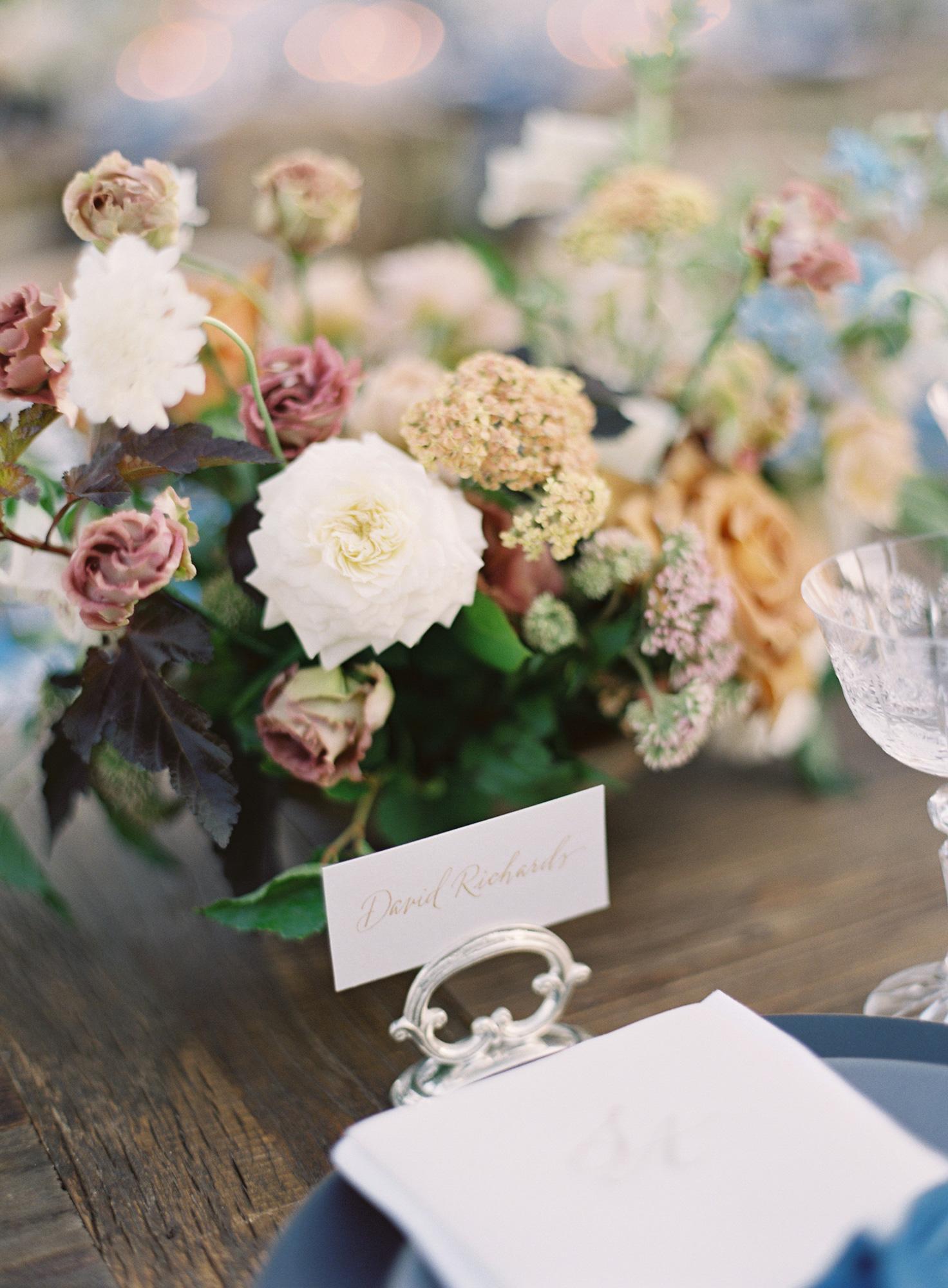 floral centerpieces white tan and mauve blooms