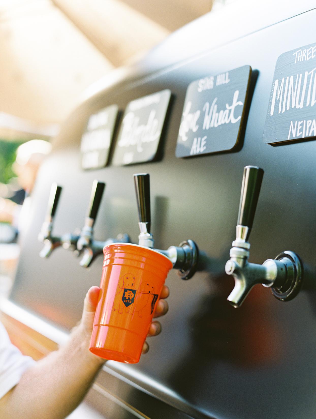 beer tap filling orange cup