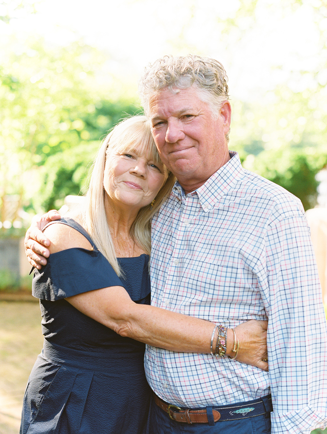couple share side hug during anniversary party