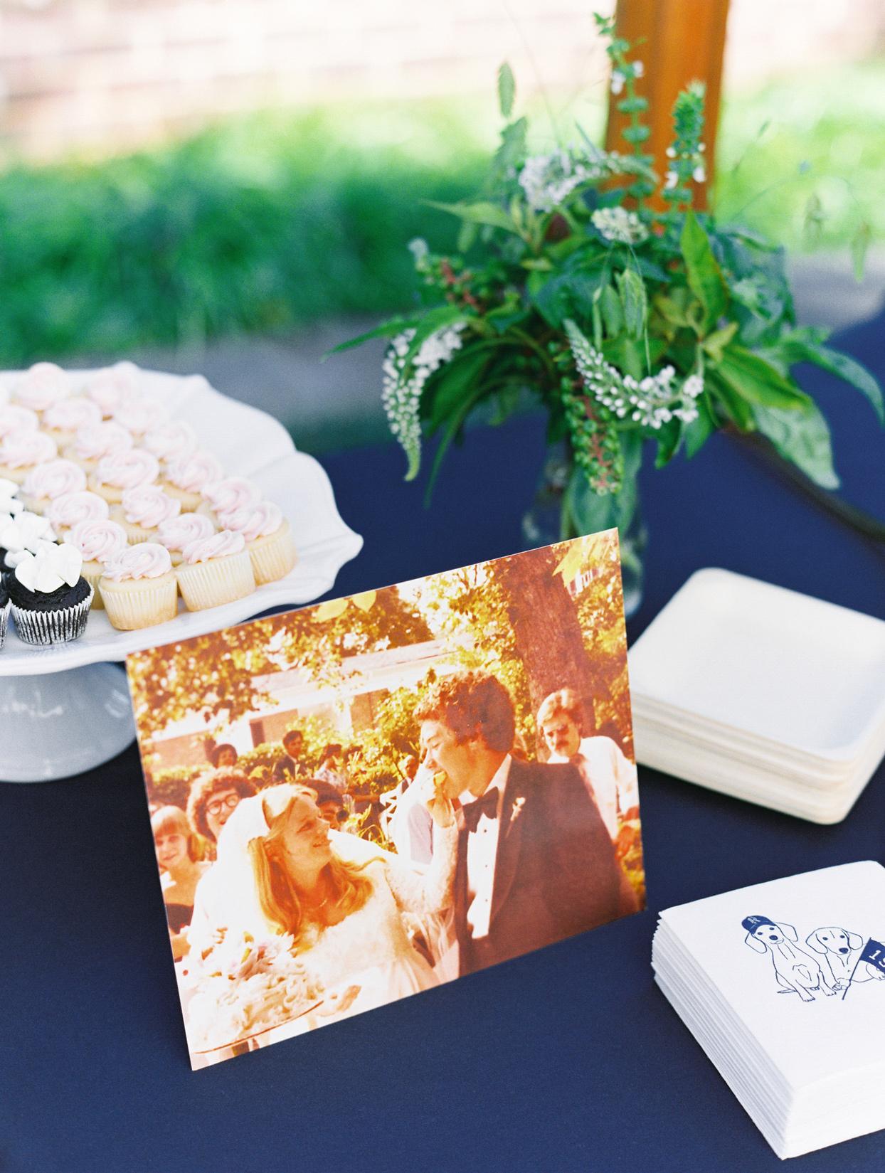 wedding photo display on cupcake dessert table