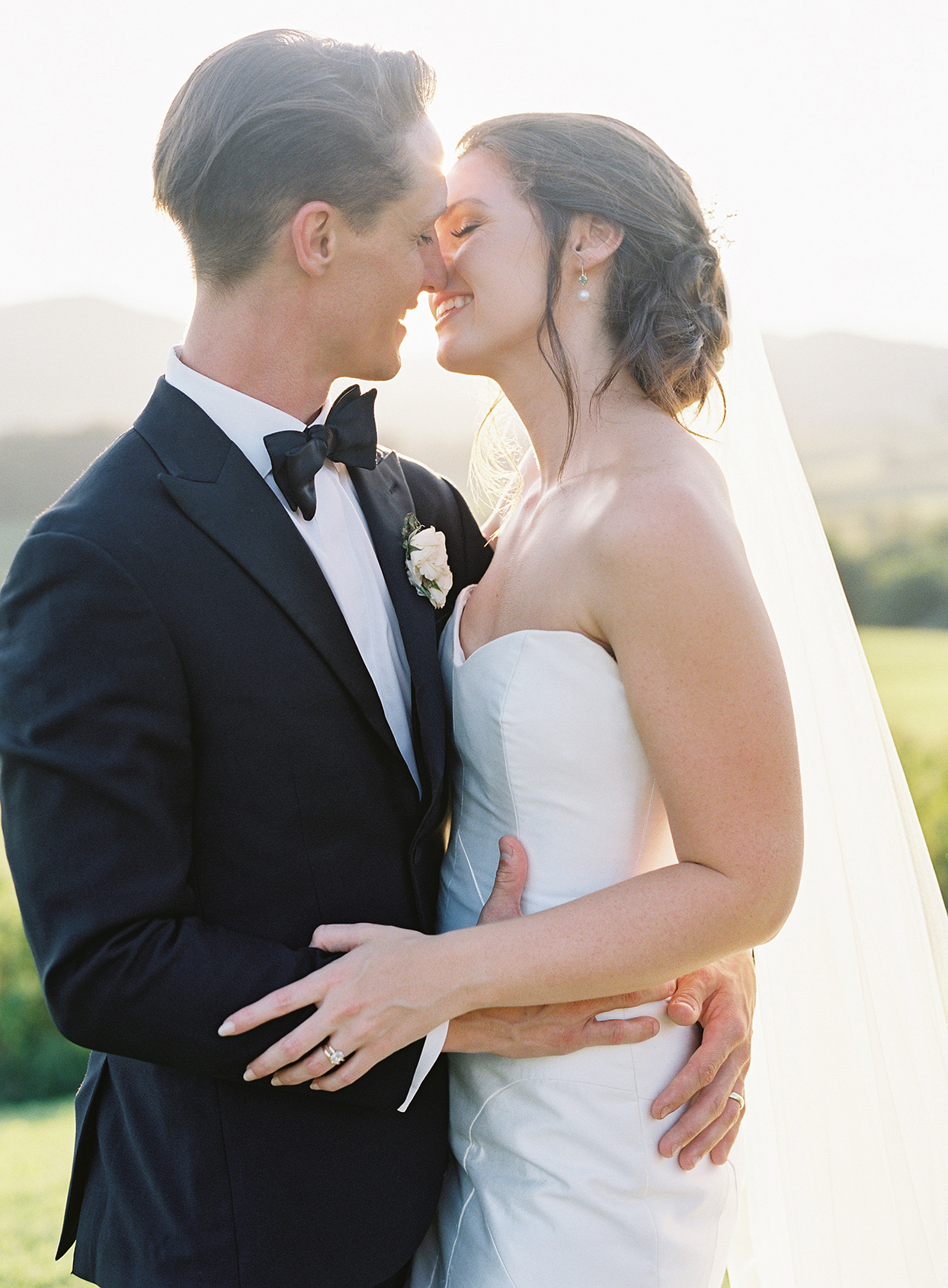 wedding couple embracing for portrait on farm
