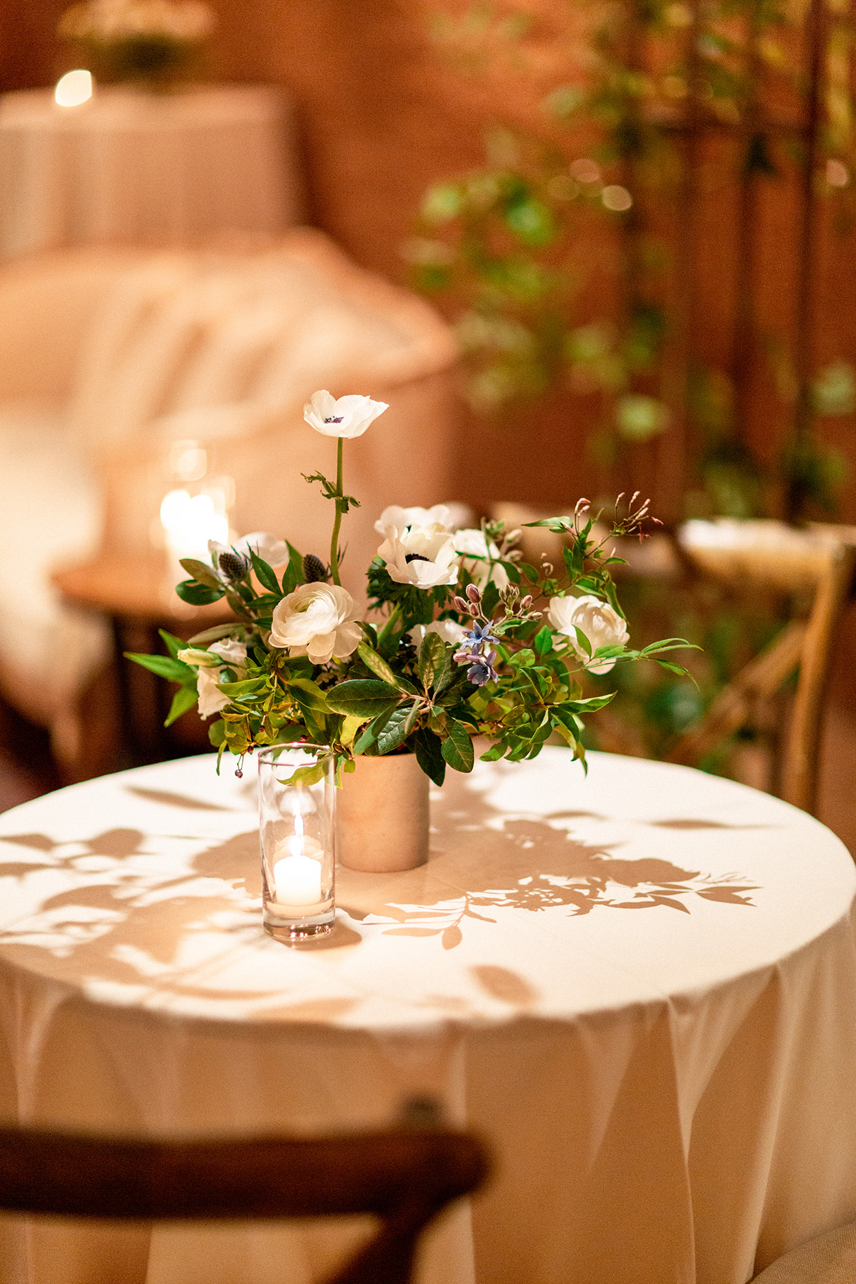 simple floral bouquet and candle on reception table