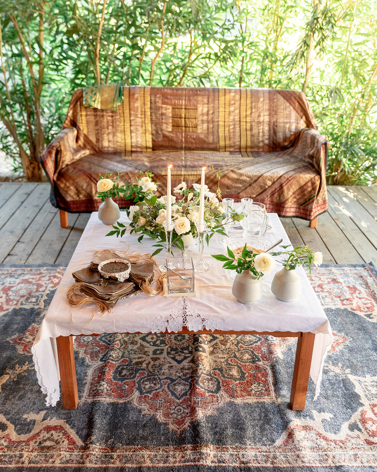 western wedding ceremony table and couch with patterned rug