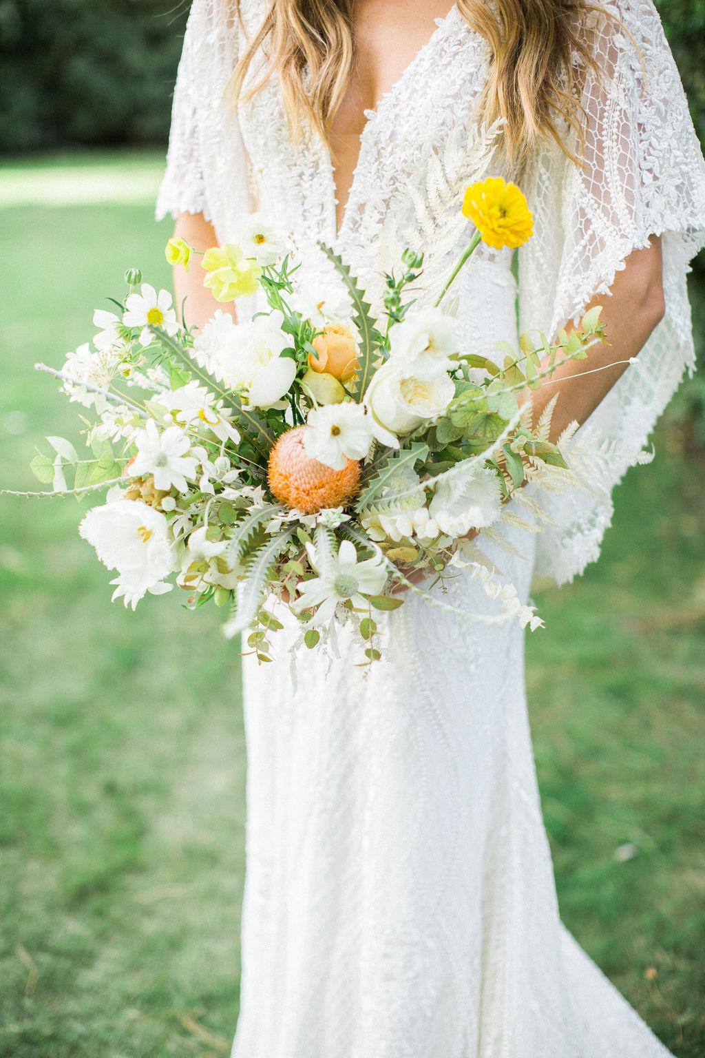 white and citrus floral wedding bouquet