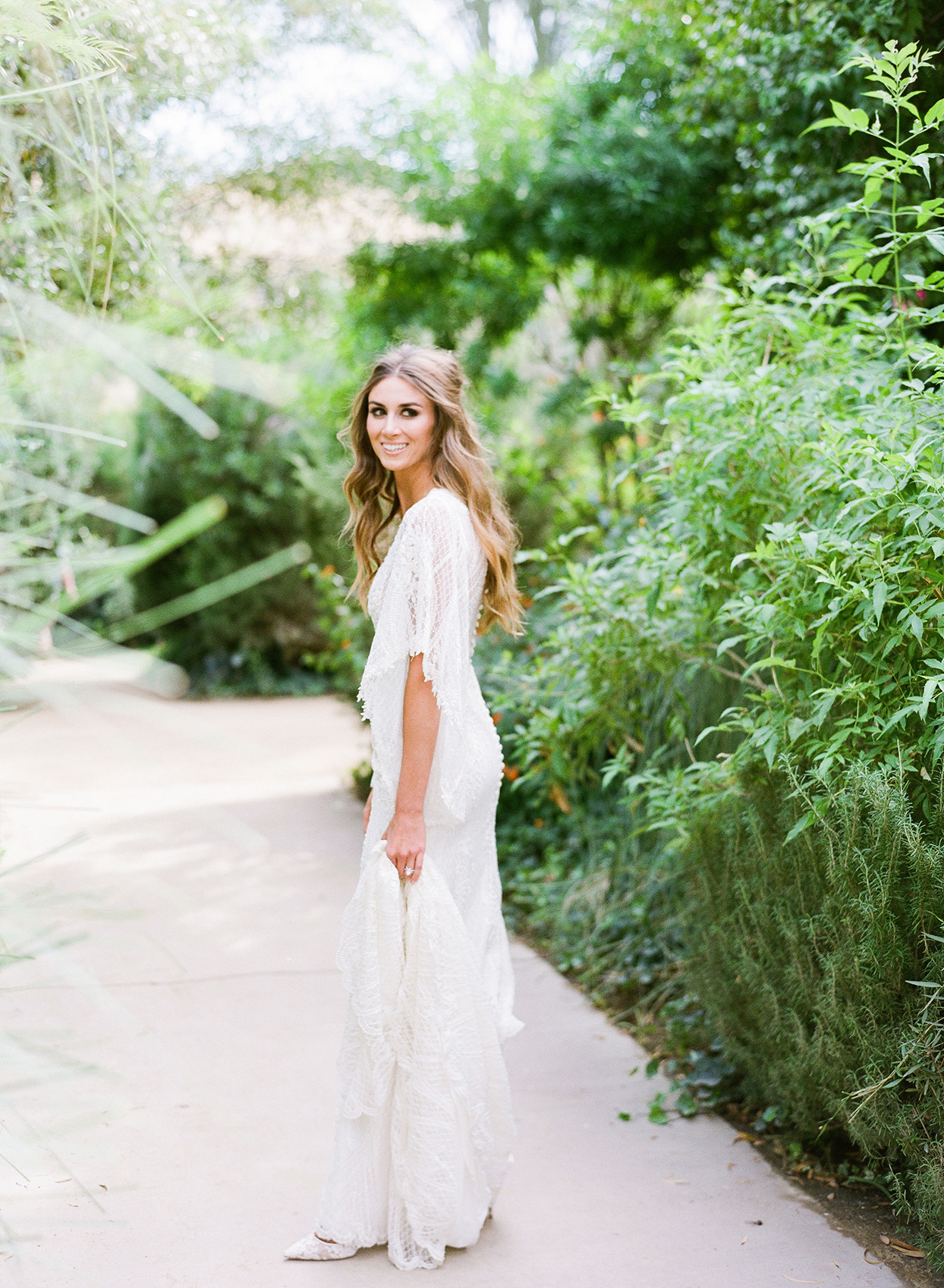 bride in flowing lace white wedding dress