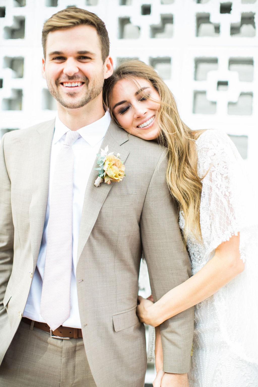 wedding couple smiling for portrait