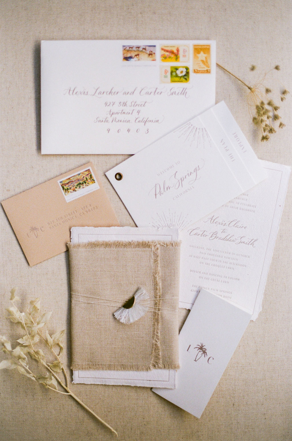simple white and sand colored desert themed wedding invitation suite