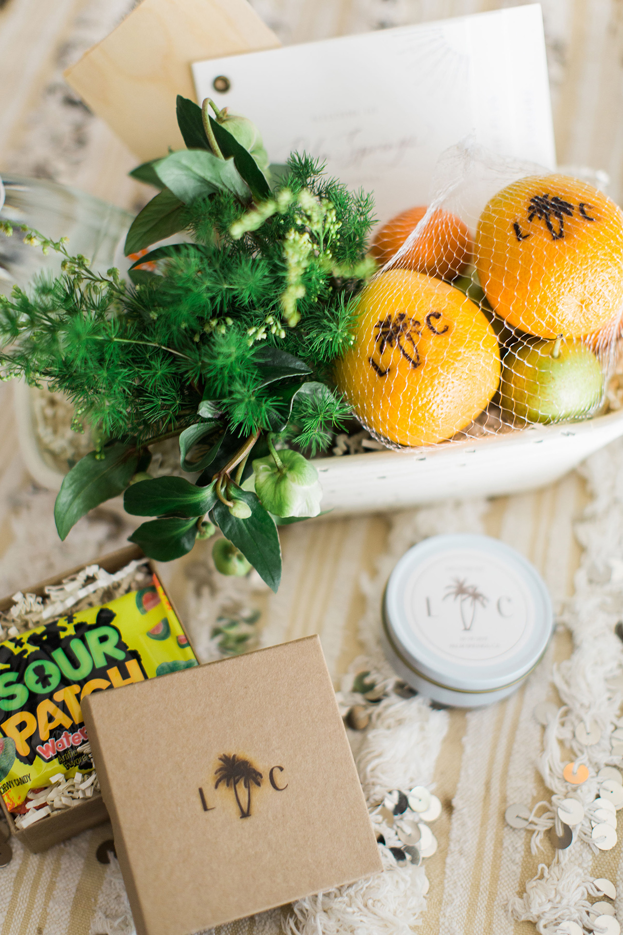 wedding welcome bags with citrus fruits and sour patch kids