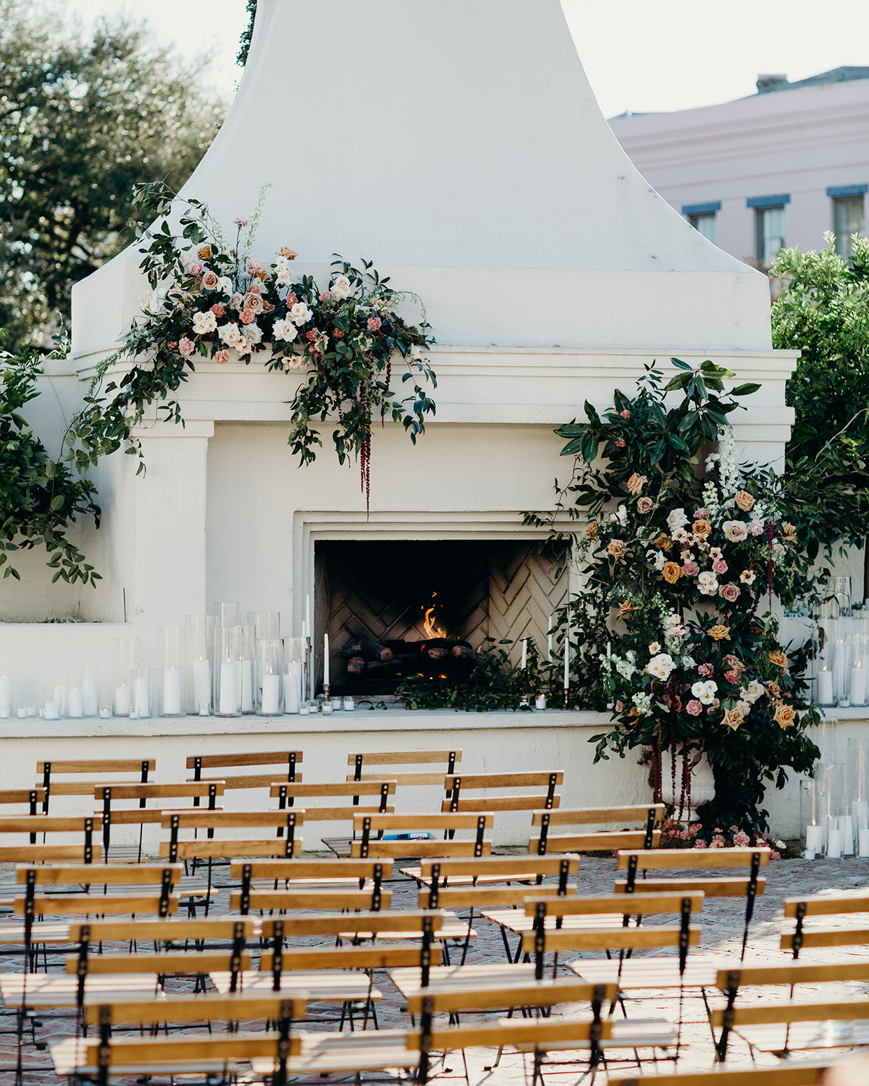wedding outdoor ceremony location with floral decor and wood burning fire