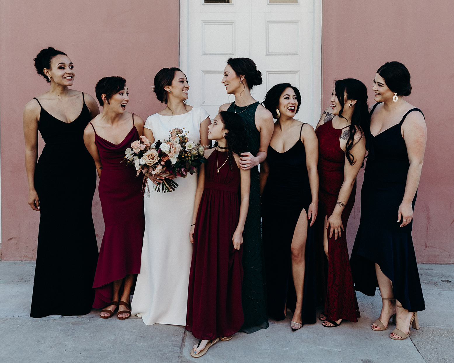 bride and wedding group in maroon and black dresses