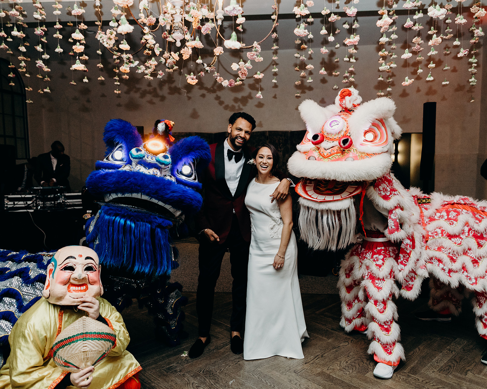 wedding reception couple during dragon dance