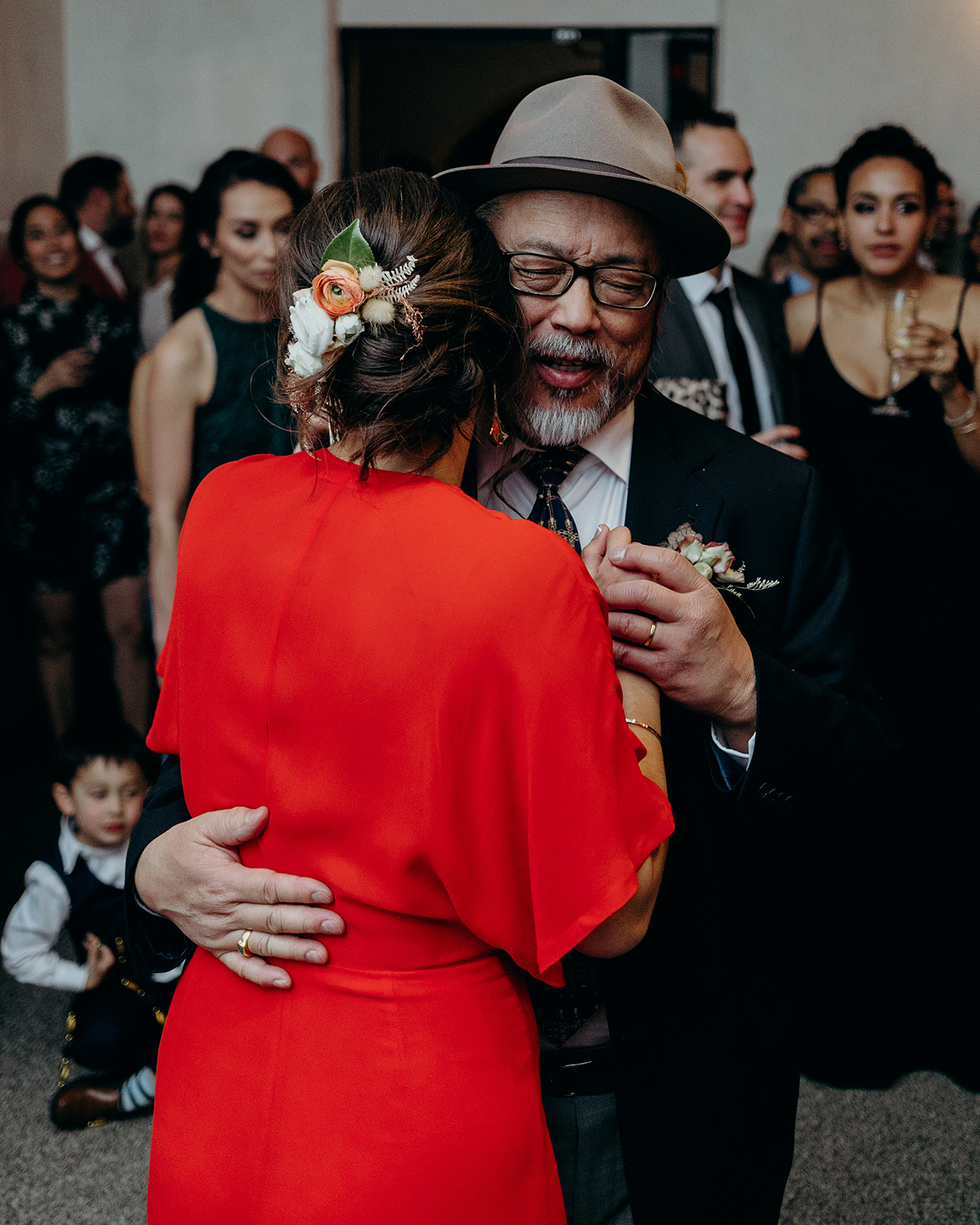 reception father dancing with bride in red jumpsuit
