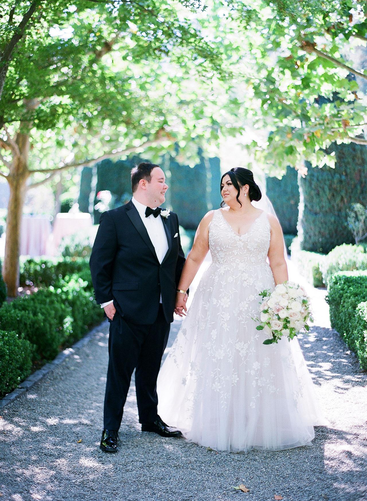 gillian tyler wedding couple holding hands