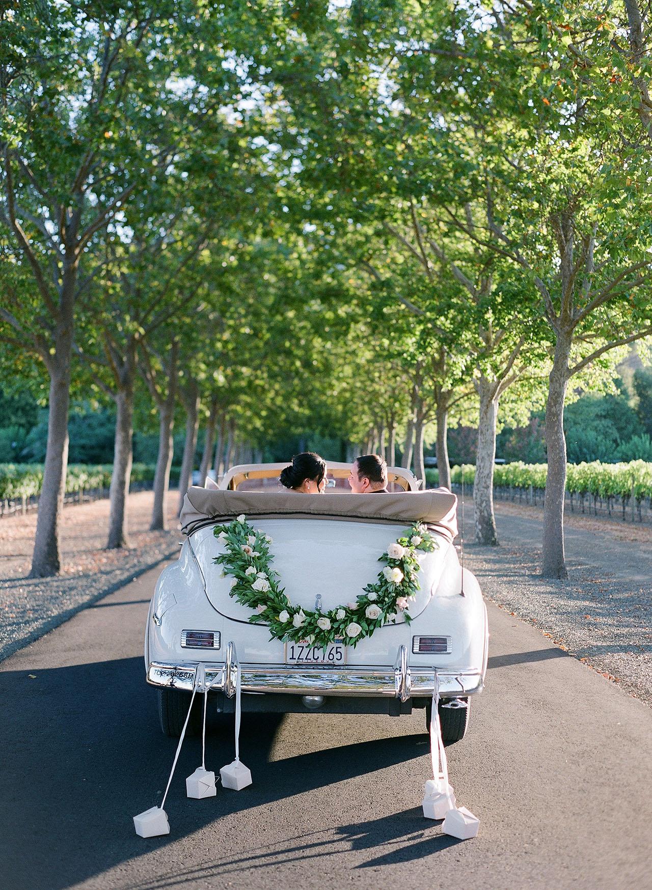 gillian tyler wedding couple driving vintage car
