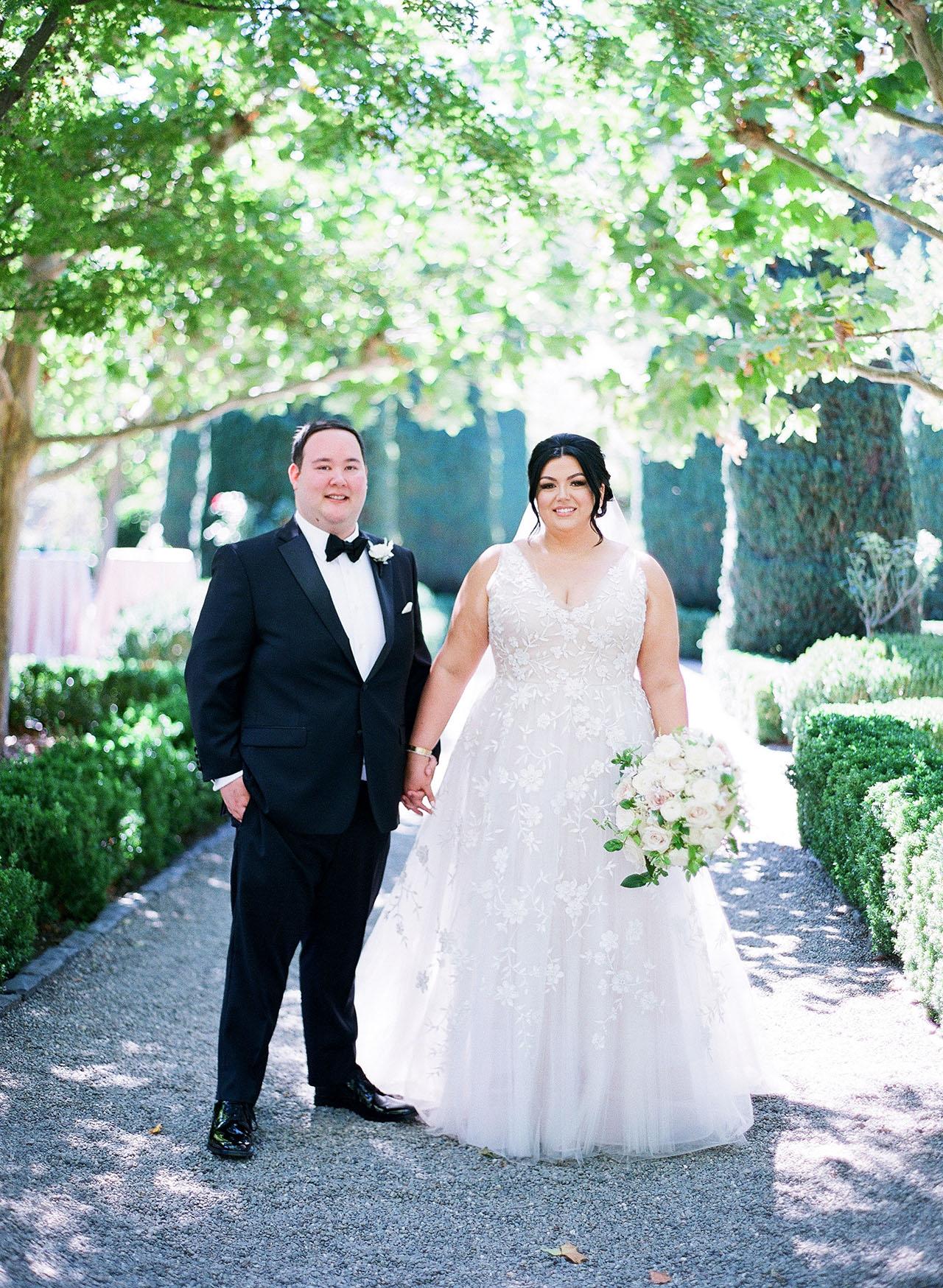gillian tyler wedding couple posing holding hands