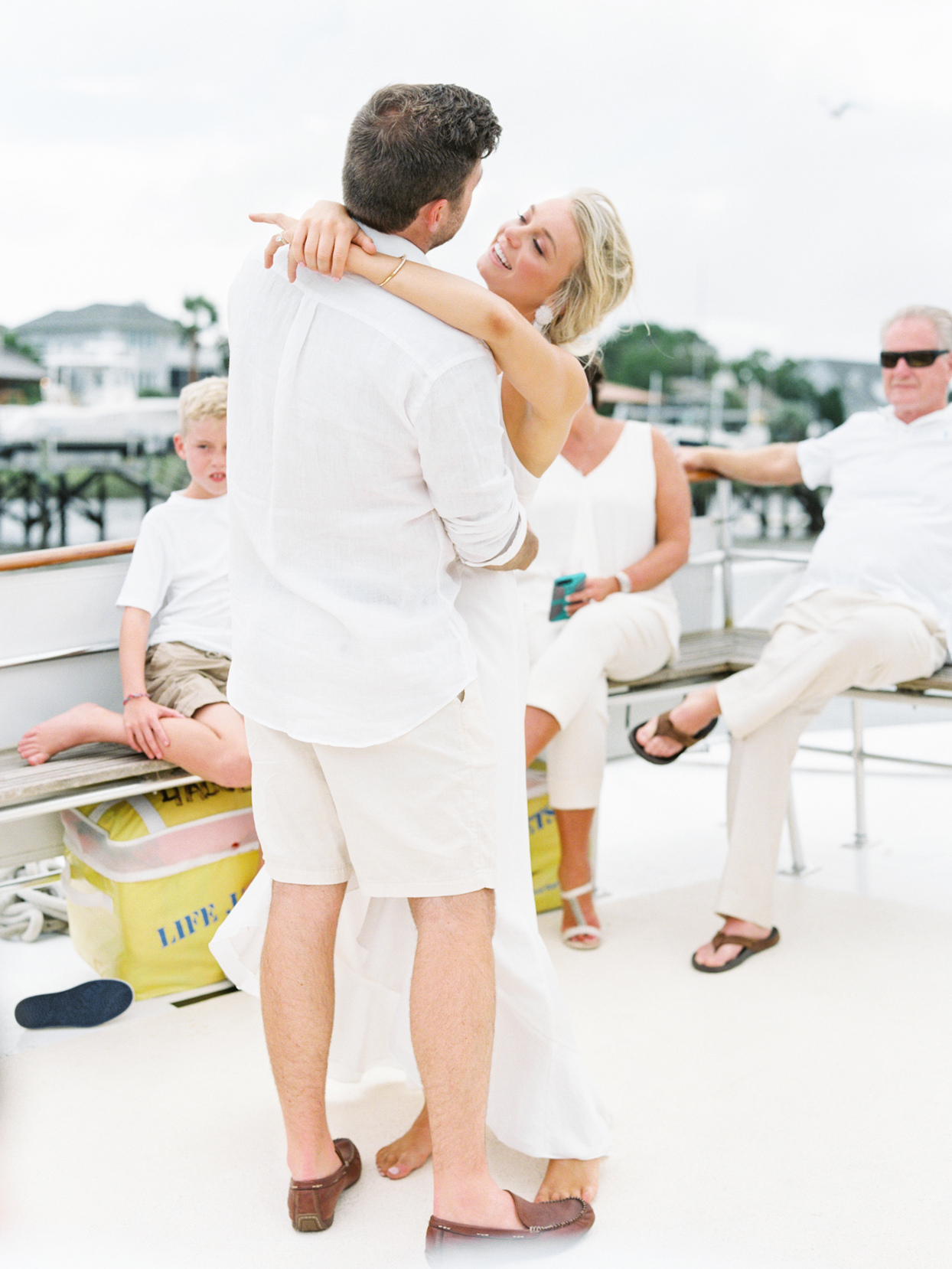 bride and groom share first dance on boat