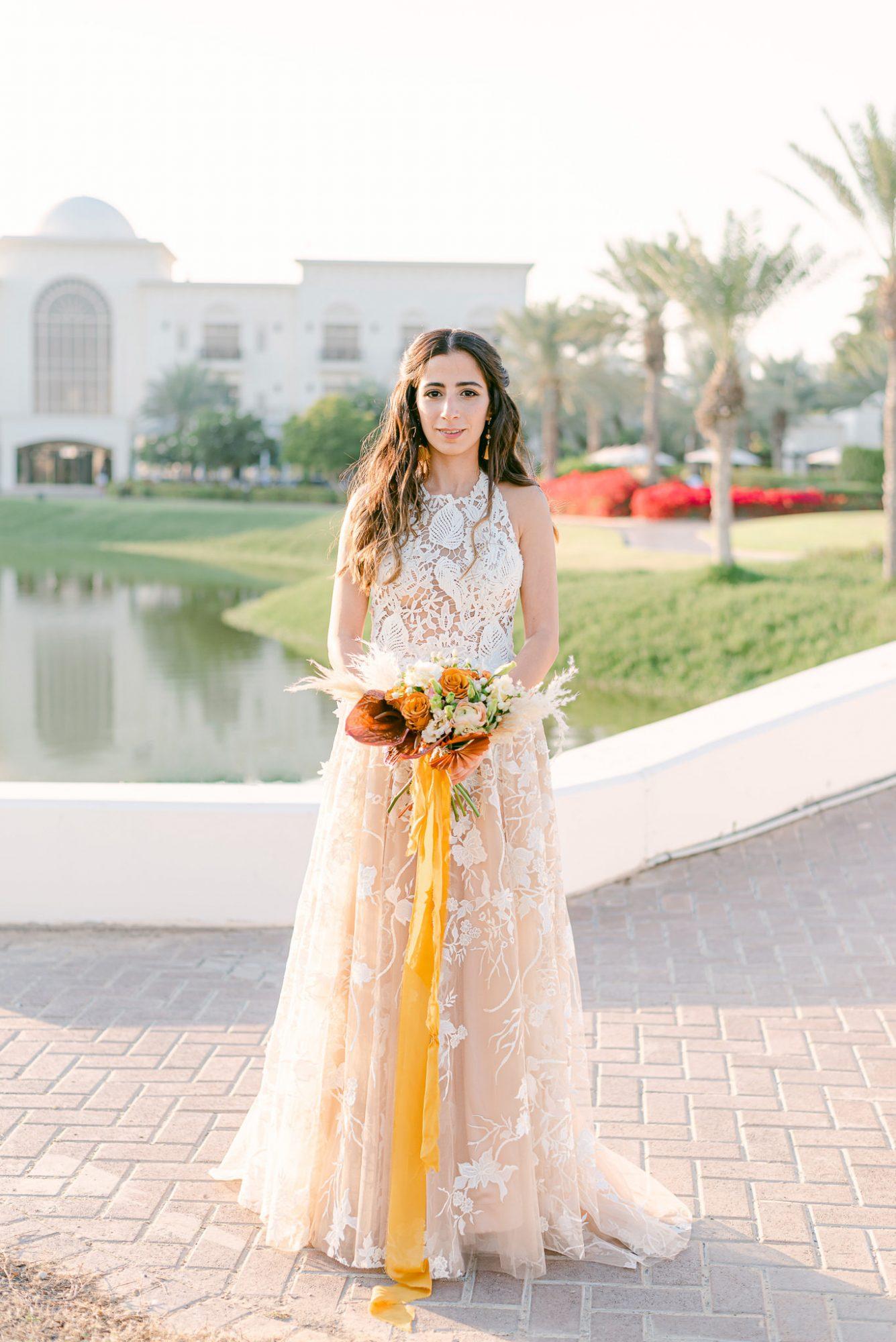 outdoor portrait bride holding bouquet