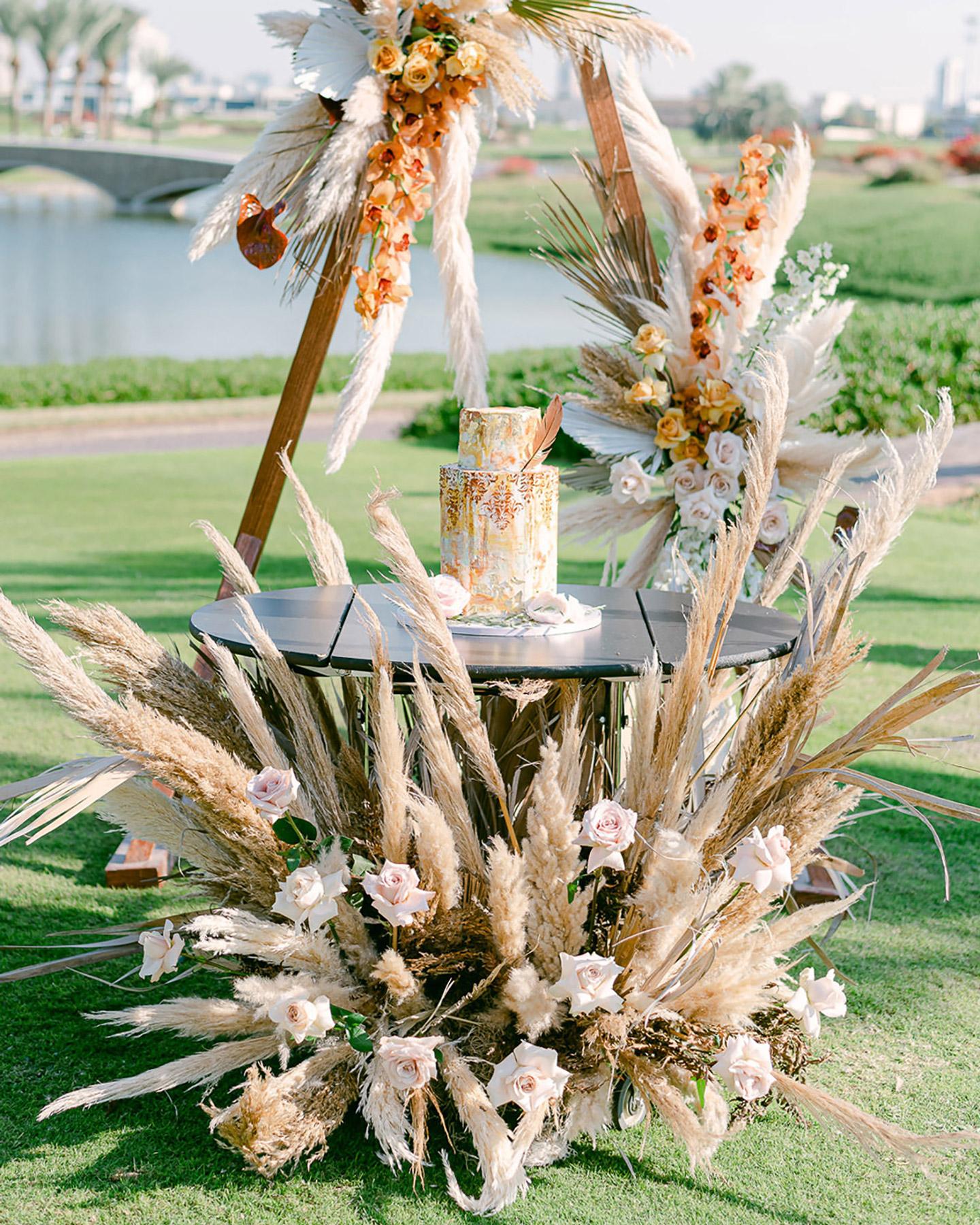 hexagon shaped 2-tier wedding cake on outdoor table