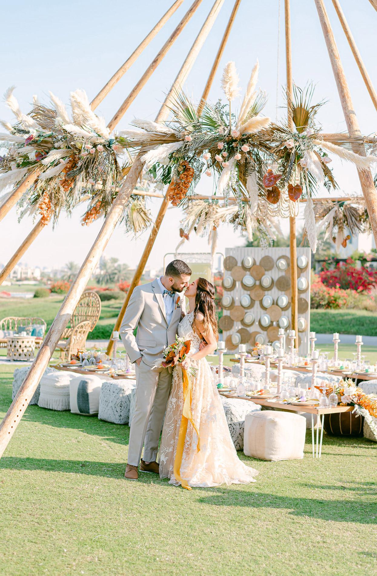 wedding couple pre-kiss in outdoor reception area