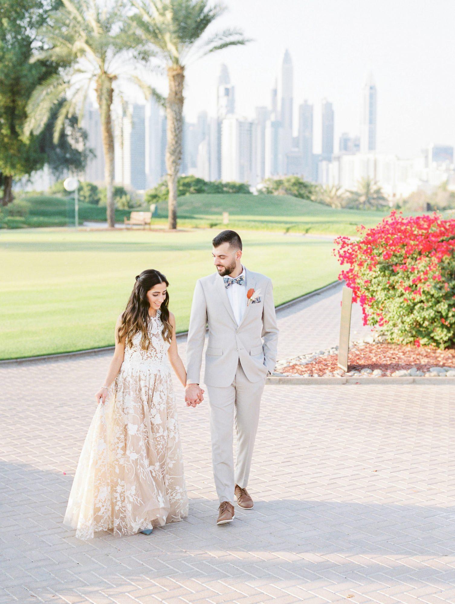 wedding couple hand in hand outdoor Dubai